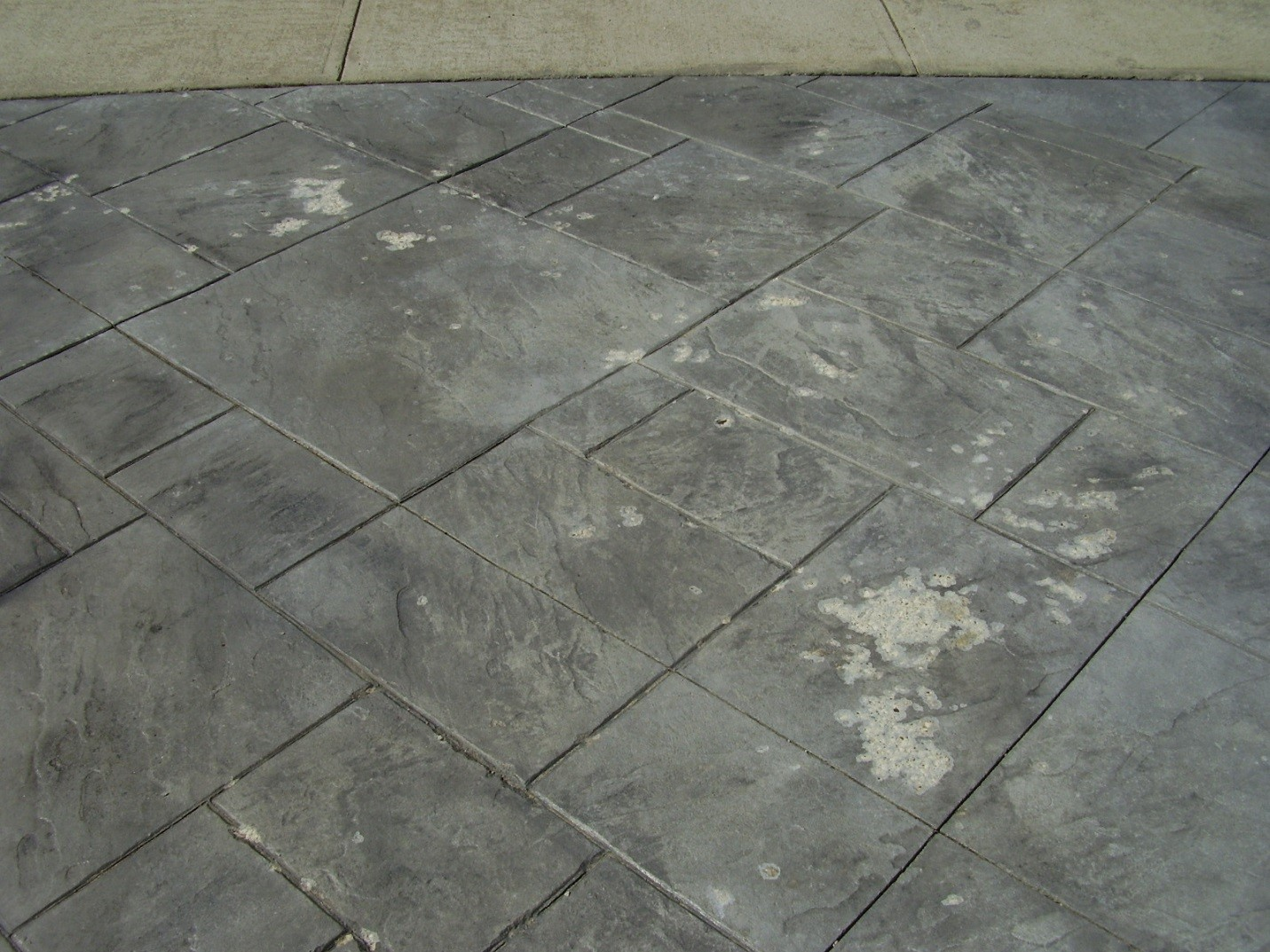 ... Stamped Concrete Stained By Ottawa Weather